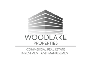 Woodlake Properties Logo with Tagline